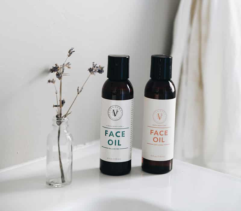 two canisters of face oil